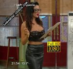 Karina Jelinek in La Peluqueria (black leather skirt and bustier)