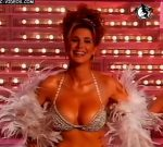 Flavia Palmiero dancing in her showgirl costume (busty beauty)